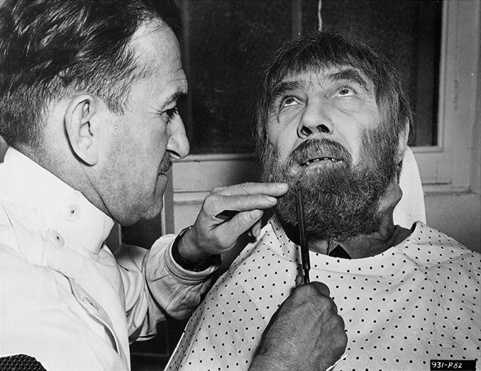 "Jack Pierce trimming Bela Lugosi's beard for his role of Ygor in ""Son of Frankenstein"""