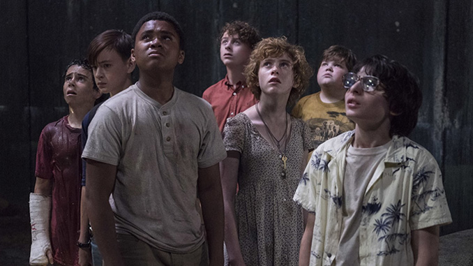 "Wyatt Oleff, Jeremy Ray Taylor, Jaeden Lieberher, Finn Wolfhard, Sophia Lillis, Jack Dylan Grazer, and Chosen Jacobs in ""It"" (2017)"