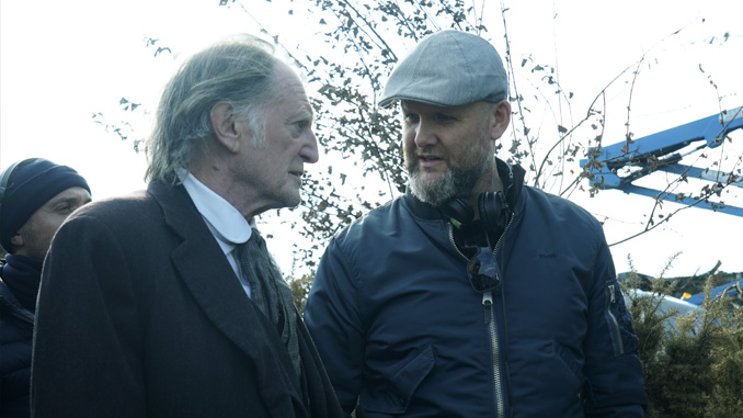 "David Bradley and Director Brian O'Malley on set of ""The Lodgers"" (2017)"